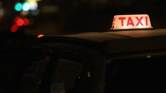 CU Passenger getting into taxi at night / Hong Kong Stock Footage