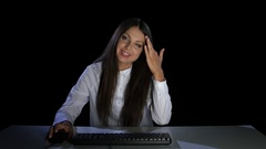 Woman laughing looking at photos of friends. Emotions. Studio Stock Footage
