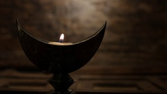 WS Lit candle in Indian candle holder Stock Footage