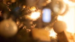 Blurred reflection of people walking on the background decorated Christmas tree. Stock Footage
