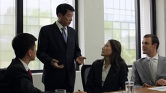 MS Young business men and woman listening to mature businessman talking / China Stock Footage