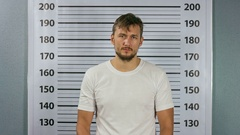 Closeup mugshot photo of man holding green screen blank sign in hands. Stock Footage