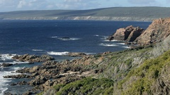 WS HA Clifs and rocky terrain overlooking sea / Australia Stock Footage