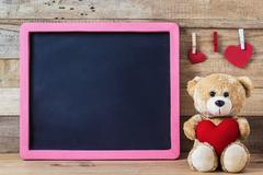 Teddy bear with heart sharp and black board Kuvituskuvat