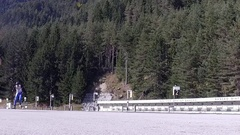 Summer biathlon training in the combined ski-biathlon complex Stock Footage