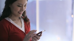 MS Young business woman using mobile phone in office / China Stock Footage