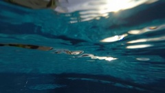 Swimming pool underwater - slow motion water ripples Stock Footage