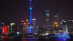 View over Huangpu River & Pudong skyline at night, Shanghai, China Stock Footage