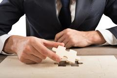 Complete a puzzle Stock Photos