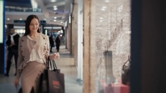 Smiling attractive young women shopping at shoes store, sexy smiling girl choose Stock Footage