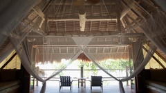 WS TU Interior of thatched villa with fan / Indonesia Stock Footage