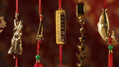 CU PAN Golden Chinese decorations depicting good fortune Stock Footage
