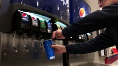 People selecting cool fountain drink from self service soda machine Stock Footage