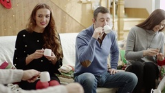 Happy familes drinking tea at christmas party Stock Footage