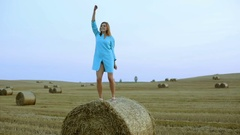 Beautiful young woman dancing in a haystack. Stock Footage