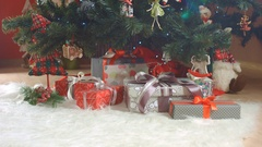 Christmas eve, New Year, gifts under the Chrismas tree, dolly in Stock Footage