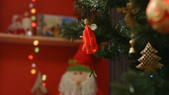 Toy doll on Christmas tree, New Year eve Stock Footage