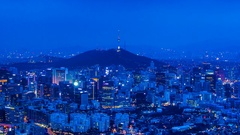 Cityscape of Seoul and seoul tower at night, South Korea.4K (zoom out) Stock Footage