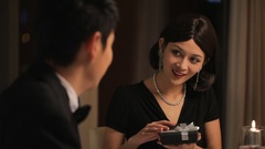 MS Young woman opening present during candle lit dinner / China Stock Footage