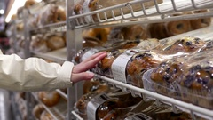 Woman buying muffin inside Costco store with 4k resolution Stock Footage