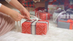 Woman hands packing gift for Christmas, New Year Stock Footage