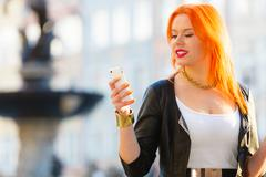 Woman fashion girl with smartphone outdoor Stock Photos