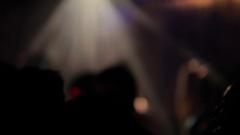 MH DEFOCUSED Flashing Lights on People Dancing in Nightclub / Singapore Stock Footage