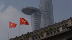 MH LA LD Vietnamese Flag Waving in front of Bitexco Financial Tower / Ho Chi Stock Footage
