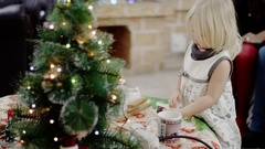 Daughter coming to table and taking candy at christmas celebration Stock Footage