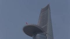 WS LA LD Vietnamese Flag Waving from Helipad of Bitexco Financial Tower / Ho Chi Stock Footage