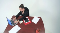 High angle view of an businesswoman working with documents and laptop. Stock Footage