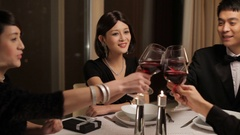 MS PAN Four people toasting during dinner party / China Stock Footage