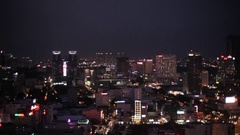 WS HA PAN Cityscape with Bitexco Financial Tower in Background at Night / Ho Chi Stock Footage
