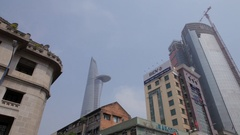 WS LA LD Older Buildings with Bitexco Financial Tower in Background / Ho Chi Stock Footage