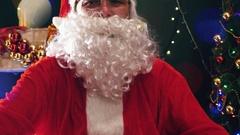 Footage of Santa Claus in eyeglasses looking at camera Stock Footage