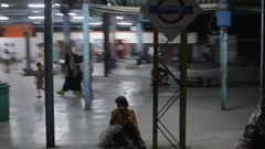 POV WS People at train station at night / India Stock Footage