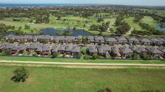 Aerial pan across Bonbeach suburban houses and Patterson river Stock Footage