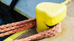 Bollard trussed wrapped with mooring rope. Stock Photos