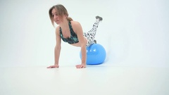 Attractive young female with fitness ball in stretching Stock Footage