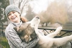Image of young girl with her dog, alaskan malamute, outdoor Stock Photos