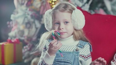 Sweet Girl hold in hands a Christmas colored candy for the child Stock Footage