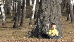 Little blonde child singing at traditional whistle and resting close at three Stock Footage
