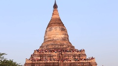 Tourist climbed to pagoda, to take pictures of sunset over Bagan, Myanmar. Burma Stock Footage
