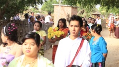 Local girls  in donation ceremony, Bagan, Burma. Myanmar Stock Footage