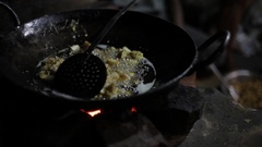 CU Food cooking in oil / India Stock Footage
