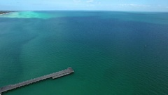Backward flight away from Rosebud pier on hot summer day Stock Footage