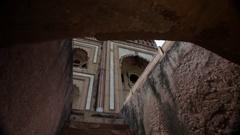 WS LA Humayun's Tomb with sun flare / New Delhi, India Stock Footage