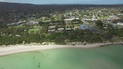 Round pan across Rosebud coastline and suburb on bright sunny day Stock Footage