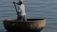 WS Fisherman Rowing in Sea in Traditional Round Boat / Vietnam Arkistovideo