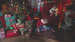 Christmas gifts for two boys. Fireplace, Christmas socks for gifts Stock Footage